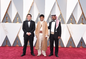 Best Foreign Film Director Naji Abu Nowar (L) and cast arrive on the red carpet for the 88th Oscars on February 28, 2016 in Hollywood, California. AFP PHOTO / VALERIE MACON / AFP / VALERIE MACON (Photo credit should read VALERIE MACON/AFP/Getty Images)